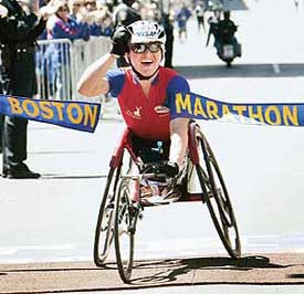 Defending Boston Marathon women's wheelchair champion Cheri Blauwet of the United States crosses the finish line to win the 109th Boston Marathon in a time of one hour, forty-seven minutes and forty-five seconds in Boston, Massachusetts April 18, 2005. REUTERS/Brian Snyder